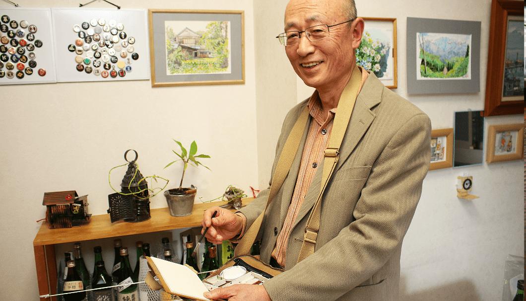 小さい水彩画セットで旅を続ける加藤忠一さん