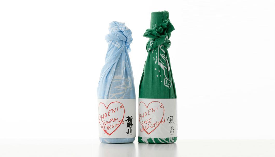 「楯野川 純米大吟醸 PHOENIX Limited Edition」と「風の森 純米大吟醸 PHOENIX Limited Edition」が風呂敷に包まれて並んでいる写真