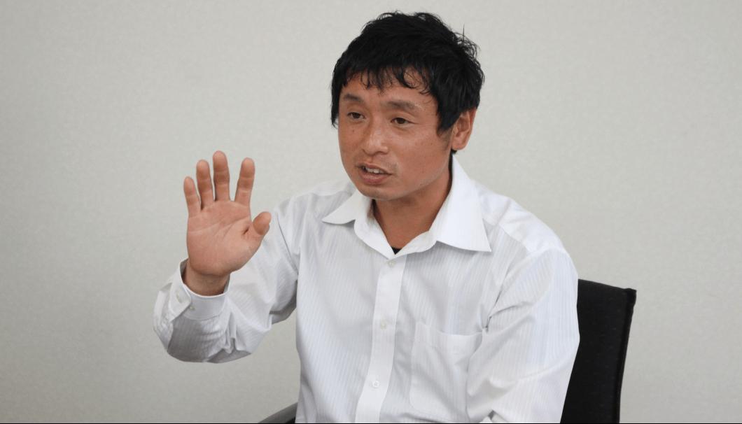 玄米家 専務取締役の藤本善仁さん