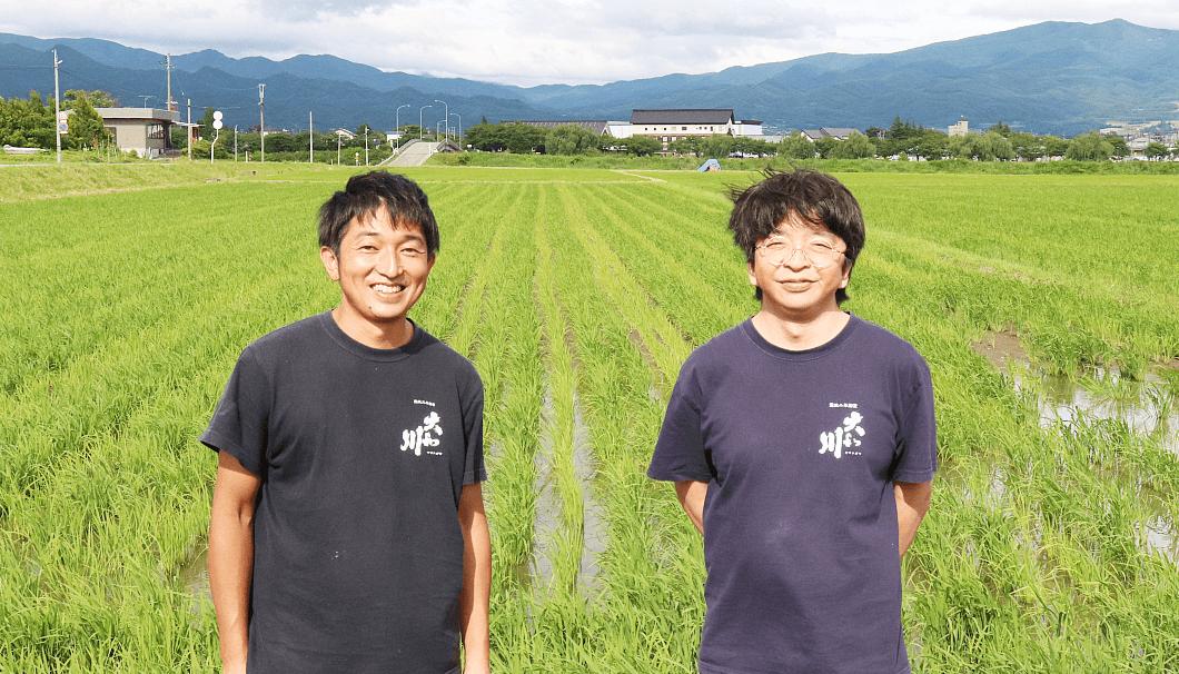 大和川酒造店 専務の佐藤雅一さん(写真右)と杜氏の佐藤哲野さん